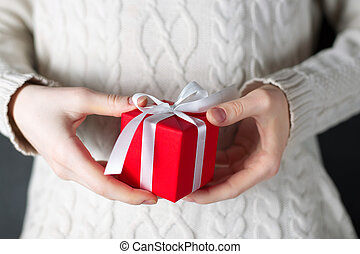 Closeup woman holding a gift