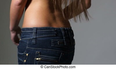 Closeup woman in jeans