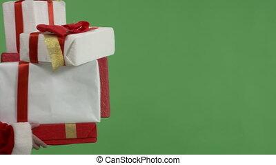 Closeup woman wearing Santa Clause with Christmas presents...