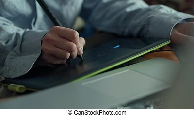 closeup womans hands with pen tablet and laptop. woman ...