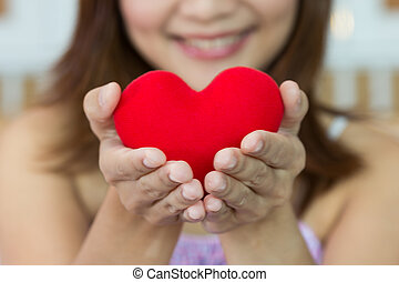 Closeup women happiness with heart shape in hands
