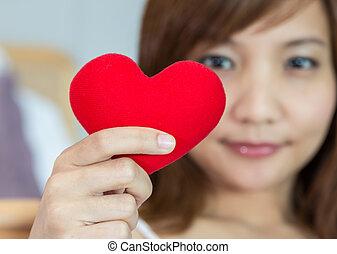 Closeup women show with heart shape in hands