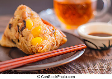 Closeup zongzi or sticky rice dumpling with tea. - Zongzi or...