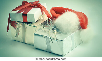 closeup.boxes with gifts and a Santa Claus hat.