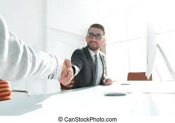 closeup.handshake business people in the office.business...