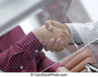 closeup.handshake colleagues