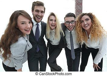 closeup.happy business team looking at camera