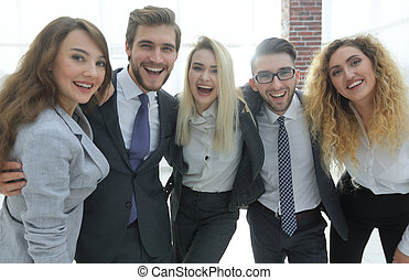 closeup.happy business team looking at camera