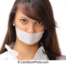 portrait of young business woman with taped mouth