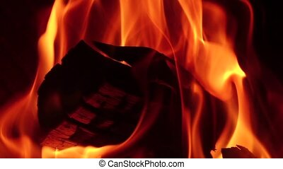 Closeups hotbed with firewood that burning red flame. Slow...