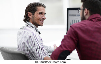 smiling employee talking with a colleague