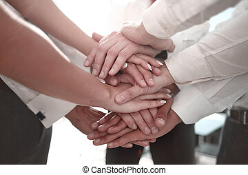 Stack of hands - real people agreement - closeup.Stack of...