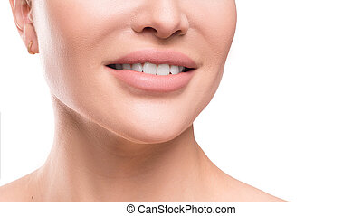 Closse up view of a female smile. Dental concept. Close up view isolated on white background.