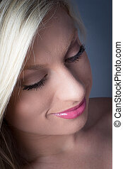 Closuep of Beautiful Blond looking down smiling