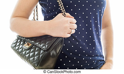 Closup isolated photo of young woman holding hand on black leather pouch
