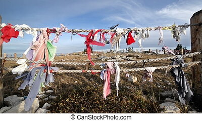 Colorful cloth blowing in the wind at Medicine Wheel National Historic Landmark in Wyoming