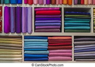Cloth fabrics at a local market in India. - Cloth fabrics at...
