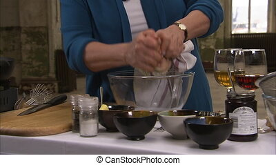 Cloth getting squeezed to pour sauce - A cloth getting...