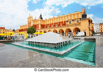 Cloth Hall on Rynek Glowny (main square) and fountain in Krakow, Poland