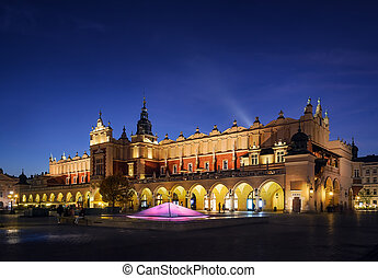 Cloth Hall Sukiennice building after sunset in Krakow city