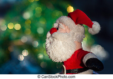 Cloth Santa Claus on a blurred background