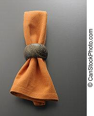 Cloth serviette with metal serviette ring