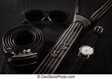 Clothes and accessories for men on the black background