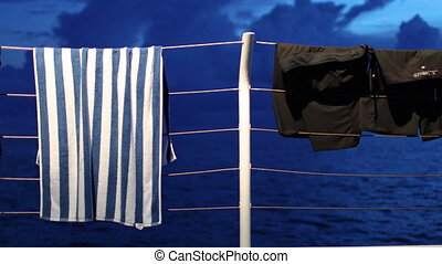 Clothes and garment on boat's rail - A medium shot of a rail...