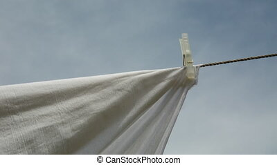 Clothes drying in the fresh air, to pin clothespins