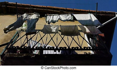 clothes drying on a balcony