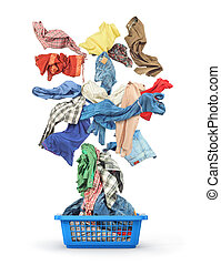 Clothes fall in to the basket isolated on white background