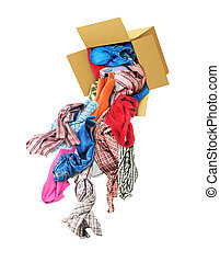Clothes fall out of a cardboard box isolated on a white background. Donation.