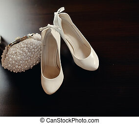 clothes for the bride - on the wooden floor are white shoes ...