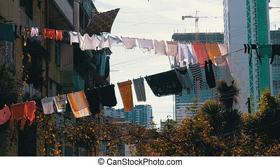 Clothes hanging and drying on a rope on a multi-story...