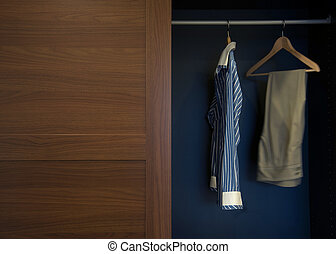 Clothes hung neatly in wardrobe wood