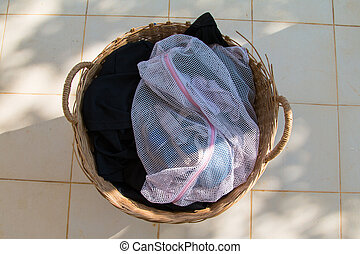 Clothes in a laundry wooden basket