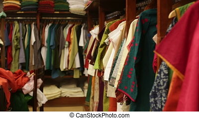 clothes lying on the shelves in the store