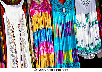 at a carnival dresses are offered for sale. competition for the textile industry.
