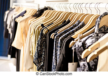 Clothes On a Rack - Clothes hang on a shelf in a designer...