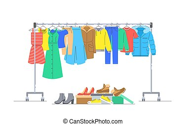 Clothes on hanger rack and shoes in boxes