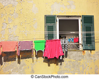 Clothes on the line by a window. Camogli, Italy