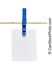 close up of a note and a clothes peg on white background with clipping path
