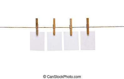 collection of various notes and a clothes pegs on white background with clipping path