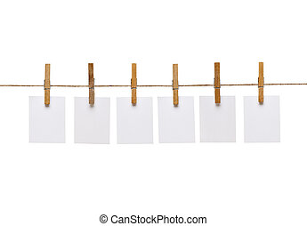 clothes peg and note paper on clothes line rope - collection...