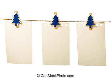 Clothes-peg in shape of Christmas tree isolated on white...