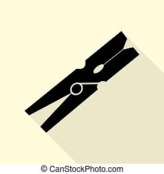 Clothes peg sign. Black icon with flat style shadow path on cream background.