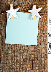 Clothes-peg in shape of star on old wooden background