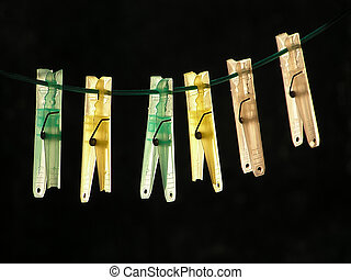 Clothes-pegs - A row of colored clothes-pegs on a wire
