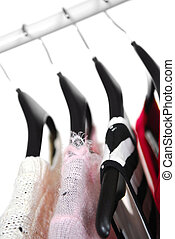 Clothes - Women\\\'s clothing on a rack on black hangers