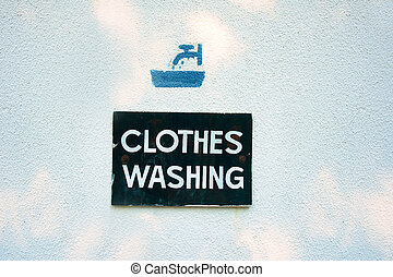 Clothes washing sign